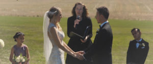 An image of a wedding couple at their ceremony in a vineyard; taken from one of our Toronto Wedding Videorgraphy videos