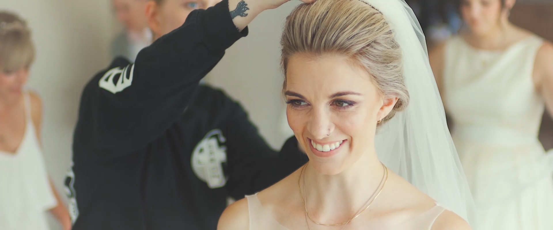 An image of a bride getting her vail placed as she prepare for her wedding day; taken from a Toronto Wedding Video