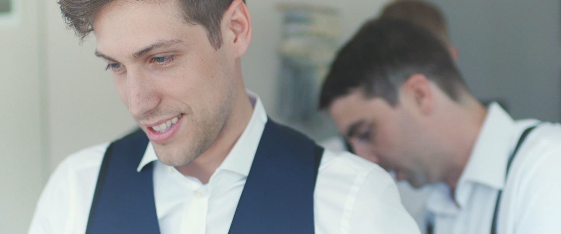 An image of a groom and his groomsmen getting ready on his wedding day; taken from a Toronto Wedding Video