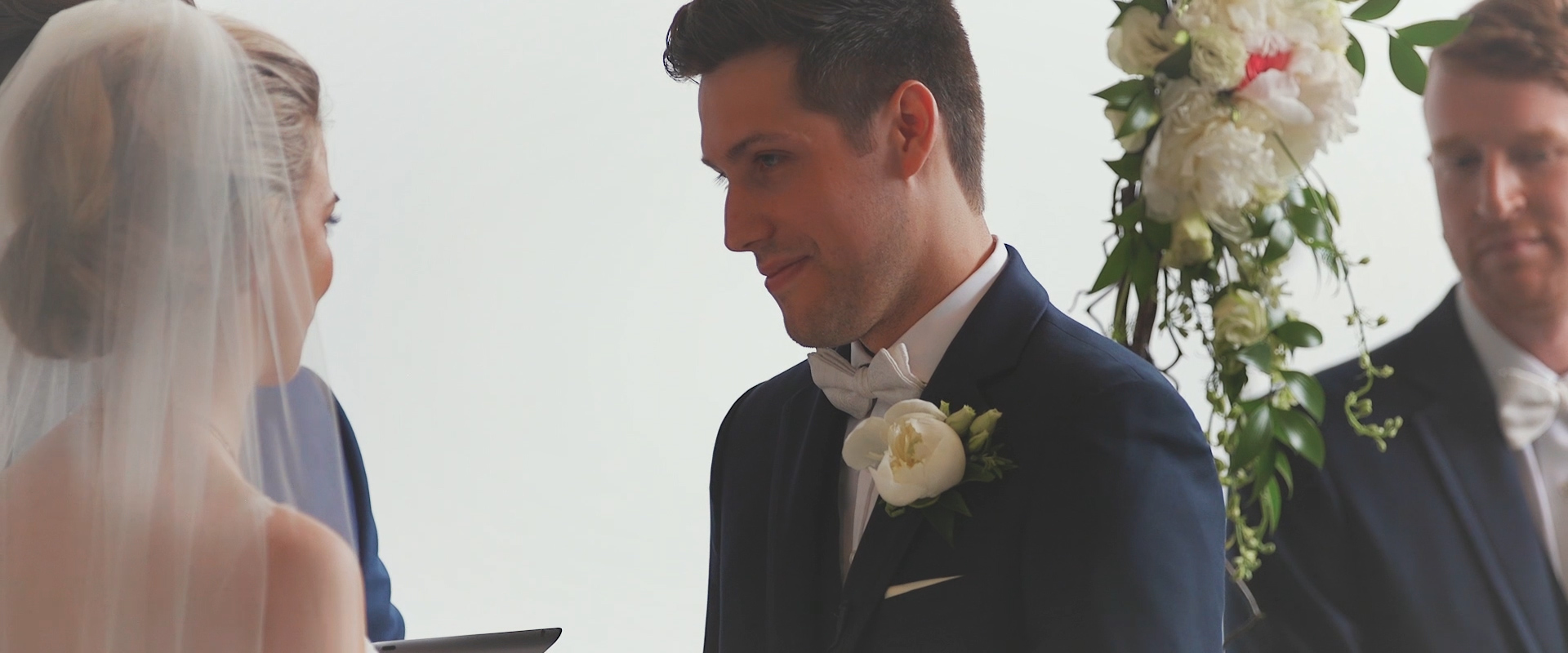 An image of a groom reciting his vows during his wedding reception; taken from a Toronto Wedding Video