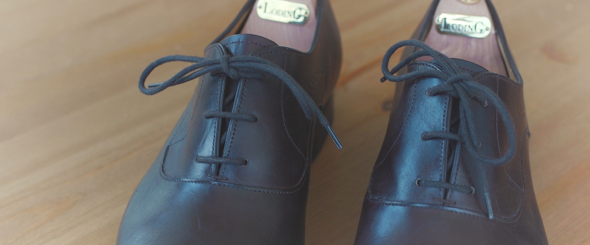 An image of a grooms wedding day shoes; taken from a Toronto Wedding Video