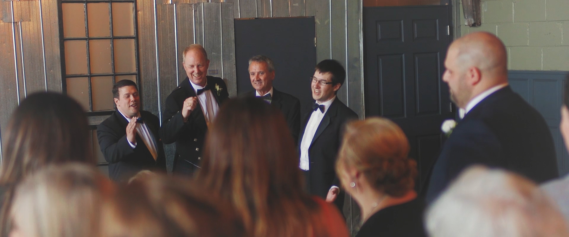 An image of a brides father and family members singing at her wedding reception; taken from a Toronto Wedding Video