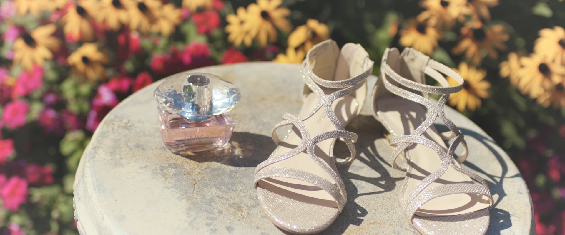 An image of a brides shoes and perfume on her wedding day; taken from a Toronto Wedding Video