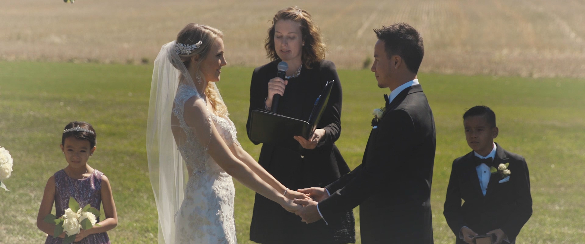 An image of a bride and groom at their wedding ceremony in Collingwood; taken from a Toronto Wedding Video