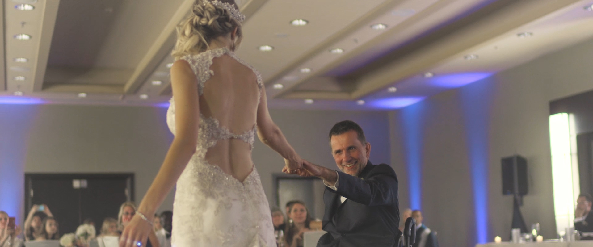 An image of a father and daughter dance at her wedding ceremony; taken from a Toronto Wedding Video