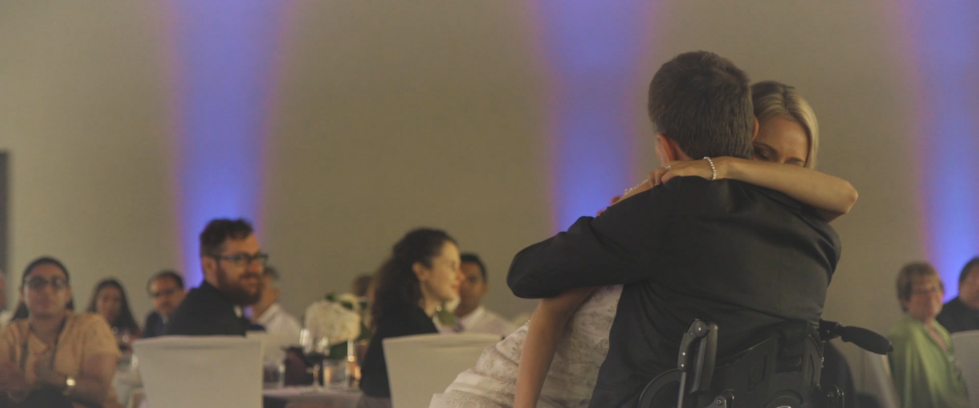 An image of a father embracing his newly wedded daughter after their first dance; taken from a Toronto Wedding Video