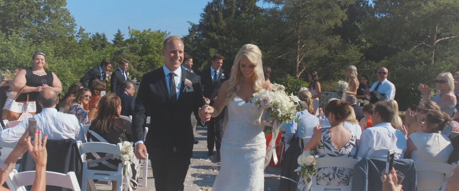 An image of a bride and groom walking down the aisle as husband and wife at king valley golf course; Toronto Wedding Video blog