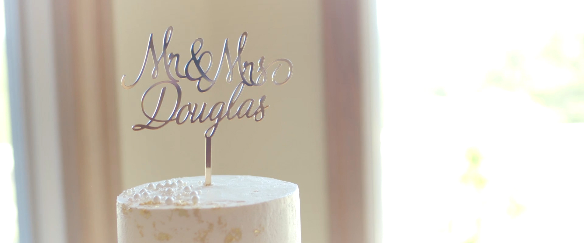 An image of a cake topper at a wedding reception; taken from a Toronto Wedding Video