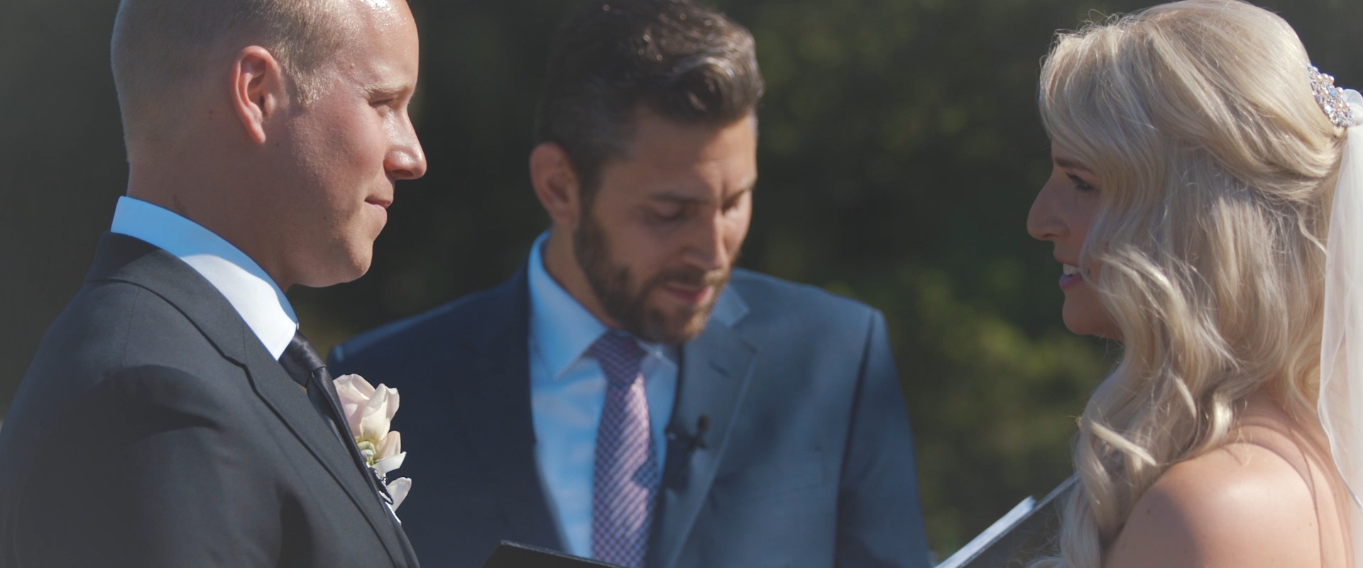 An image of a couple at their wedding ceremony; taken from a Toronto Wedding Video