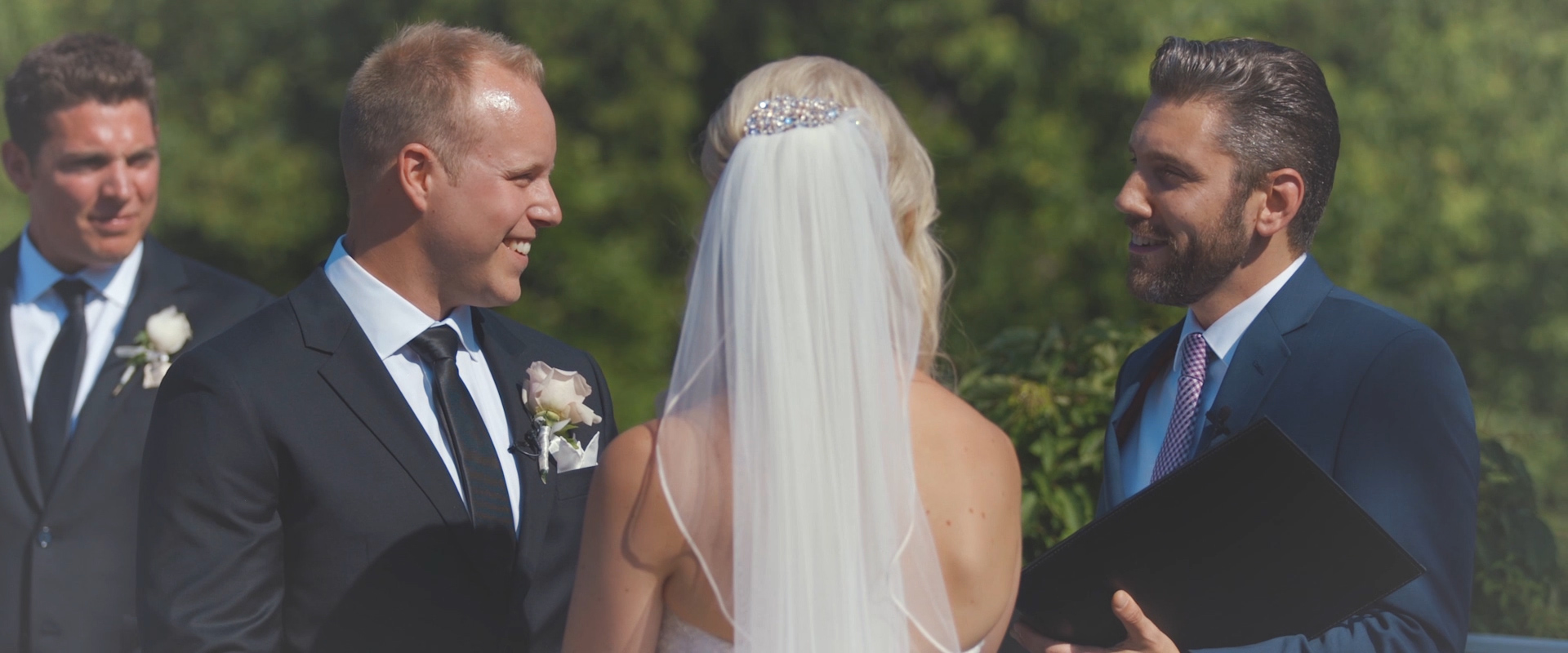 An image of a couple during their wedding ceremony at king valley golf club; taken from a Toronto Wedding Video