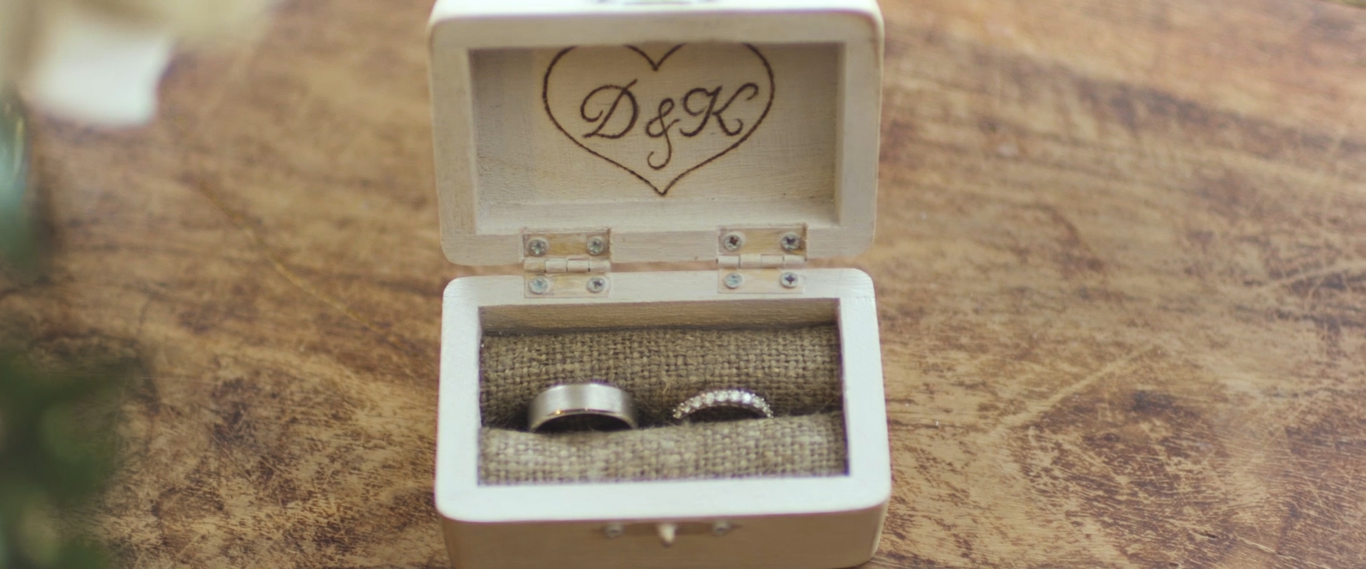 An image of a couples wedding rings on the day of their wedding; taken from a Toronto Wedding Video