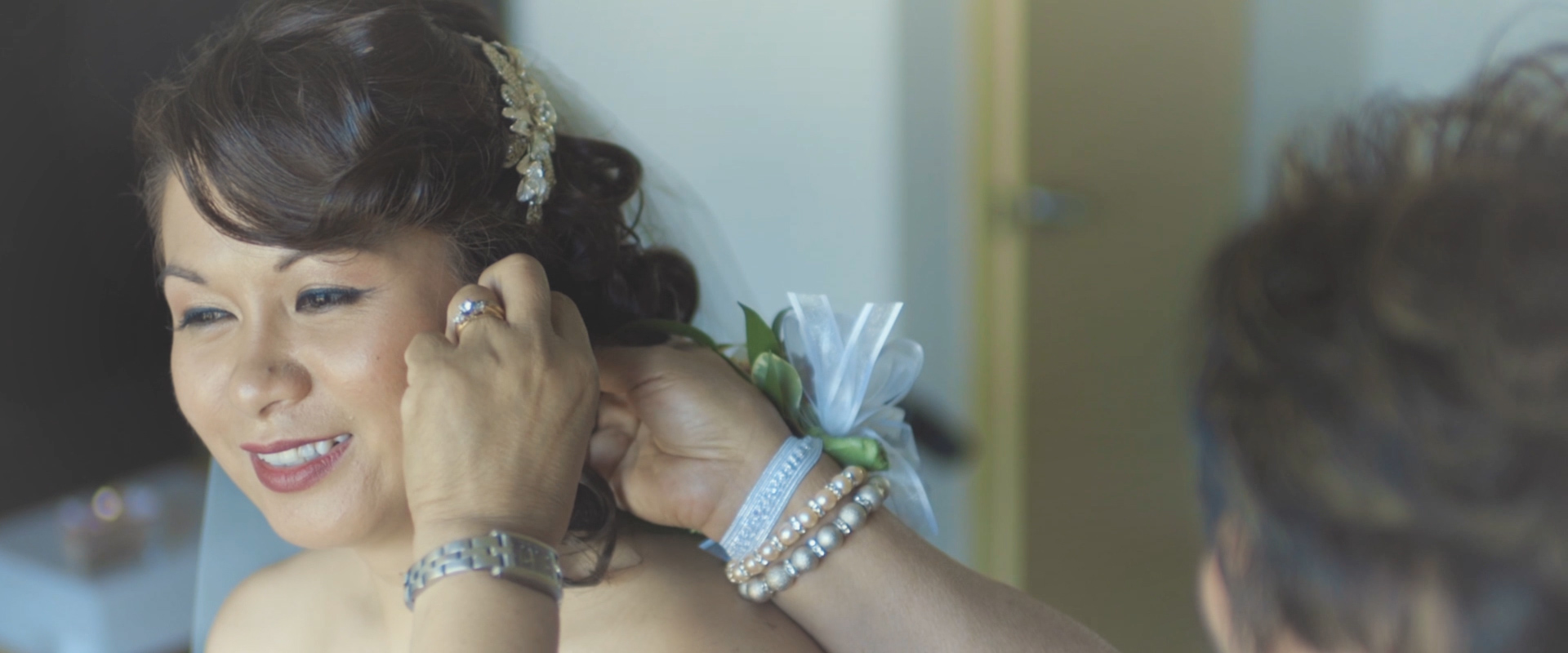 An image of a bride getting ready on her wedding day; taken from a Toronto Wedding Video