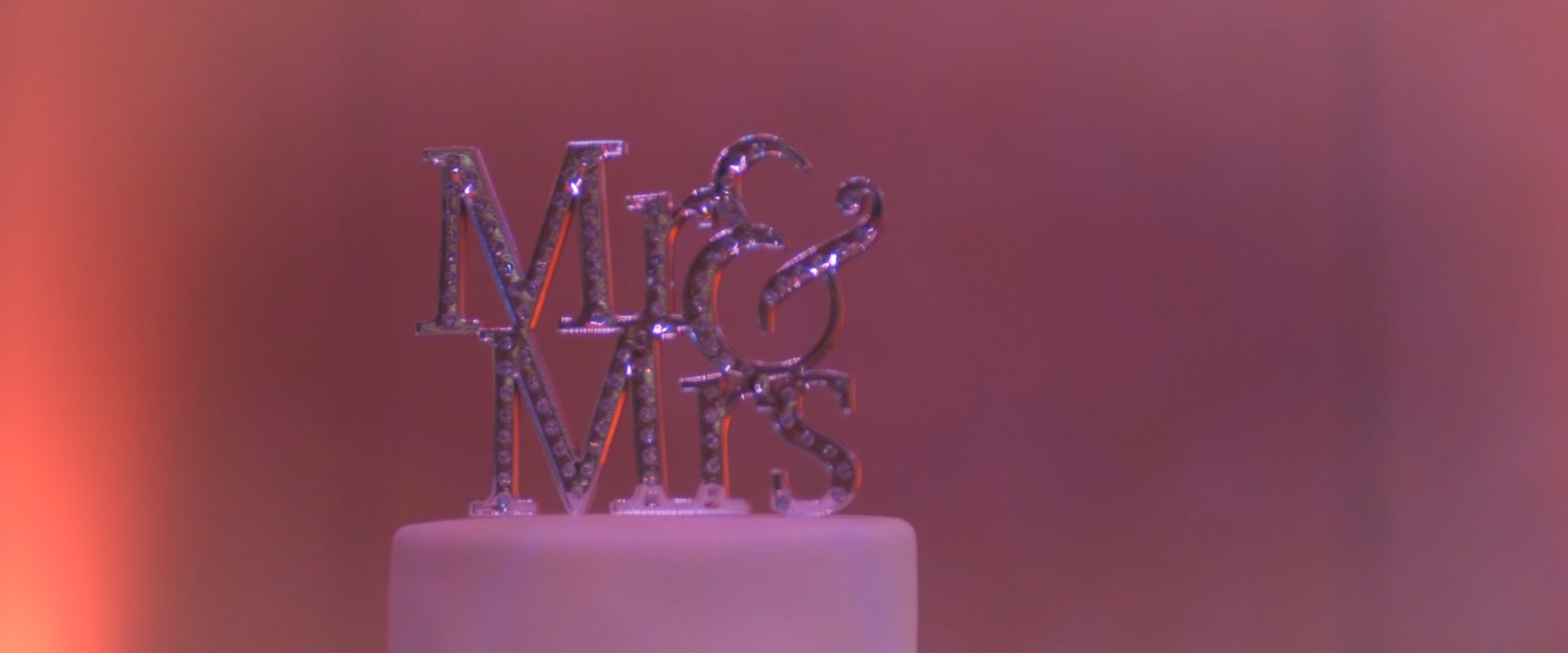 An image of a cake topper; taken from one of our Toronto Wedding Videos