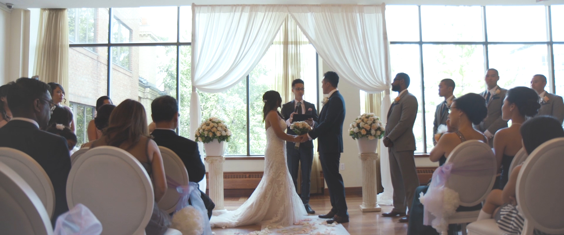 An image of a bride and groom at their wedding ceremony; taken from a Toronto Wedding Video