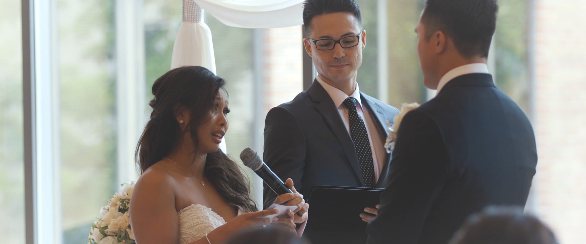 An image of a bride reciting her vows at her wedding ceremony; taken from a Toronto Wedding Video