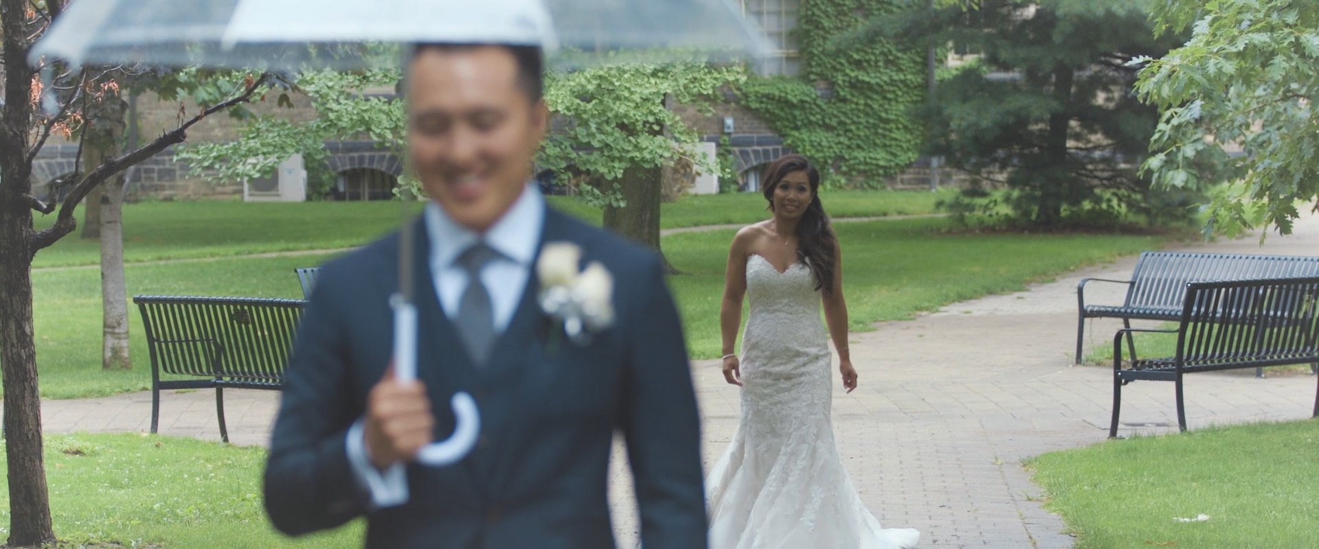 An image of a bride as she approaches her groom during their first look at the University of Toronto; taken from a Toronto Wedding Video