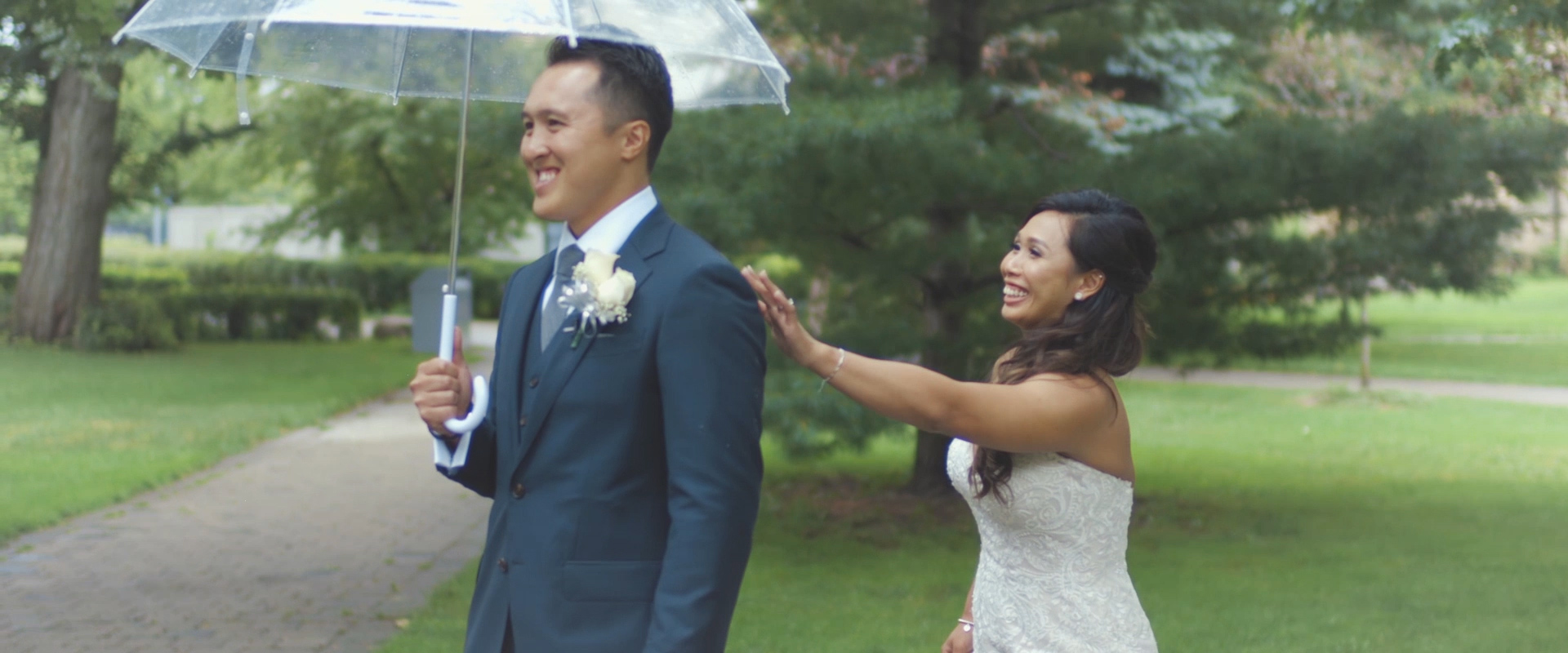 An image of a bride and groom during their first look at the university of Toronto; Toronto Wedding Video blog