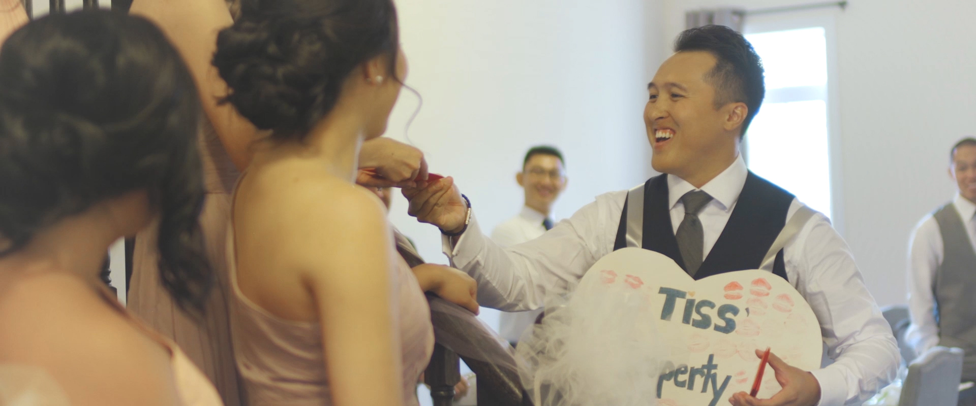 An image of a groom participating in traditional games on his wedding day; taken from a Toronto Wedding Video