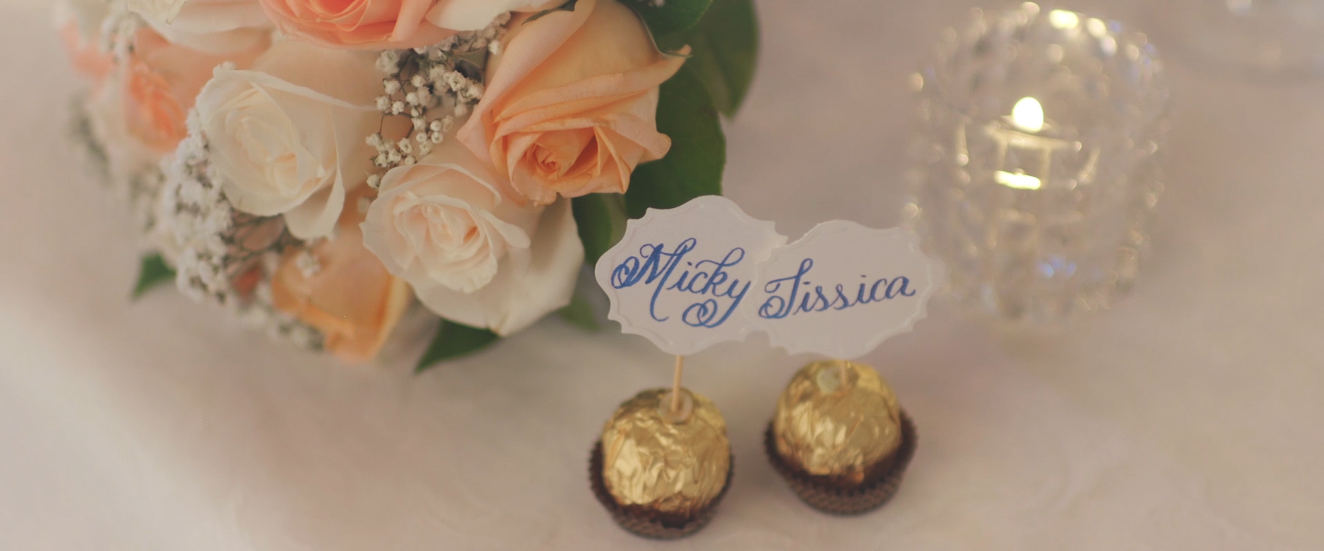 An image of a bride and grooms table decor at their reception hall; taken from a Toronto Wedding Video