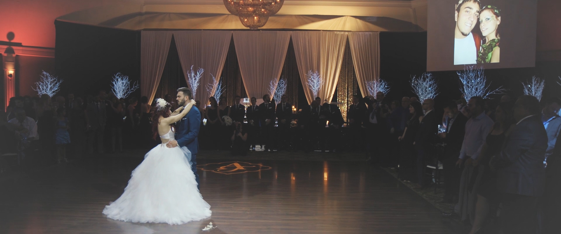 An image of a bride and groom during their first dance at their reception; taken from a Toronto Wedding Video