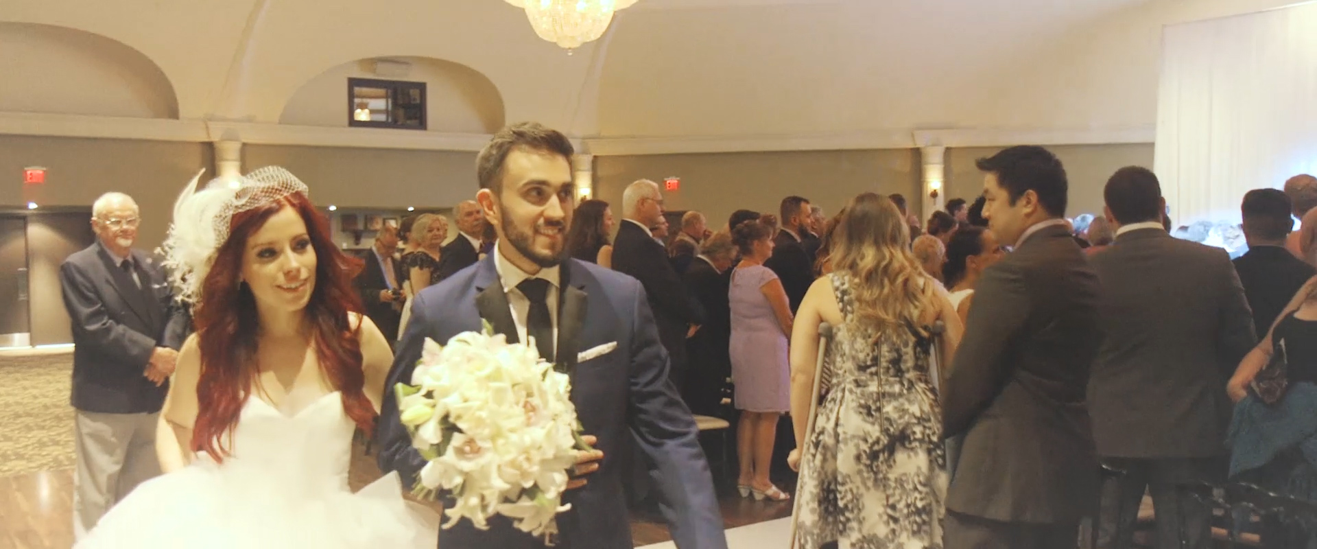 An image of a bride and groom walking down the aisle as husband and wife; taken from a Toronto Wedding Video