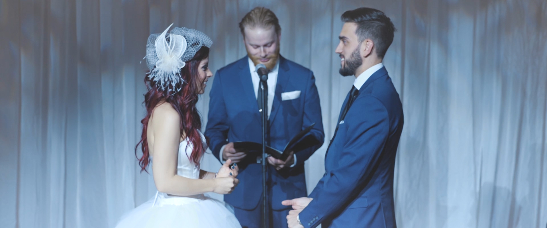 An image of a bride and groom at their ceremony on their wedding day; taken from a Toronto Wedding Video