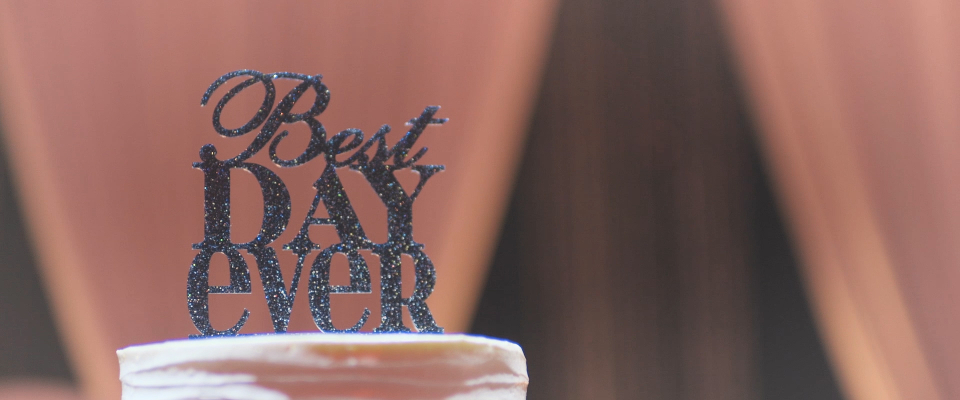 An image of a cake topper; taken from a Toronto Wedding Video