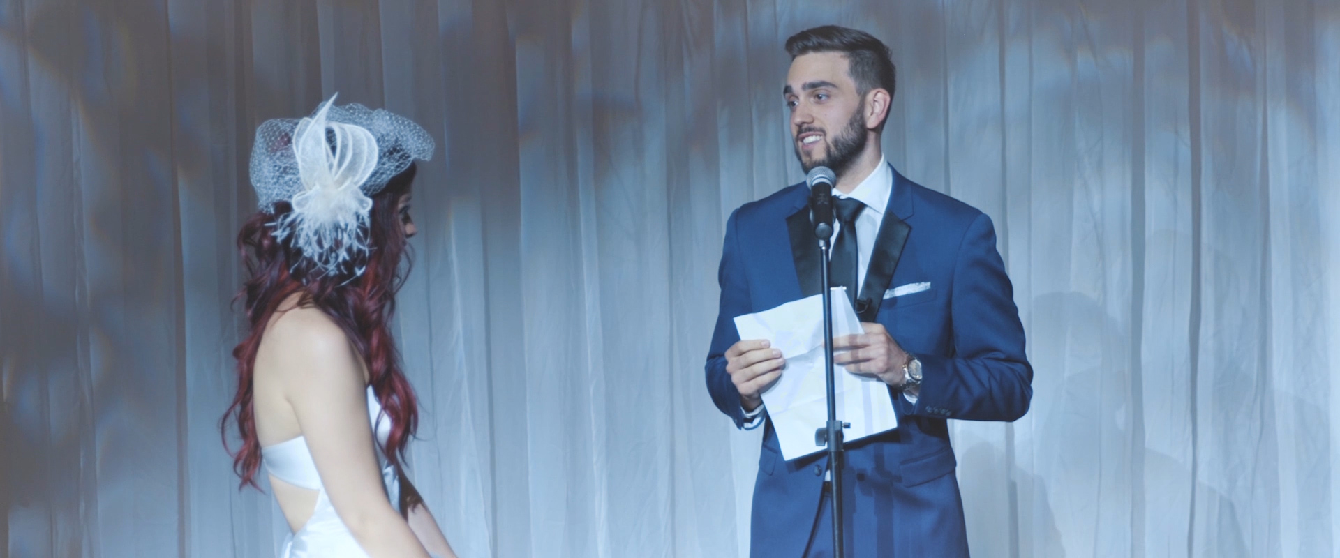 An image of a groom reading his vows during his wedding ceremony; taken from a Toronto Wedding Video