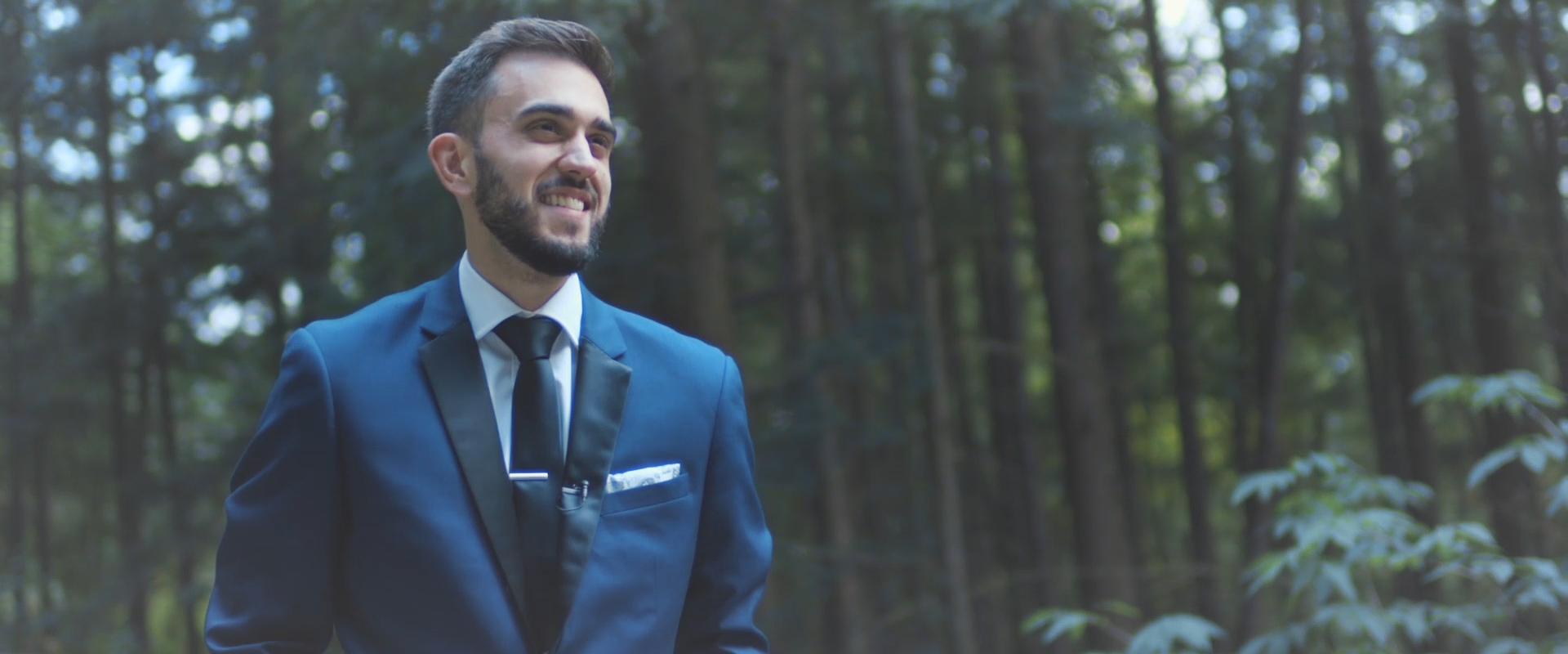 An image of a groom waiting for his bride during their first look; taken from a Toronto Wedding Video