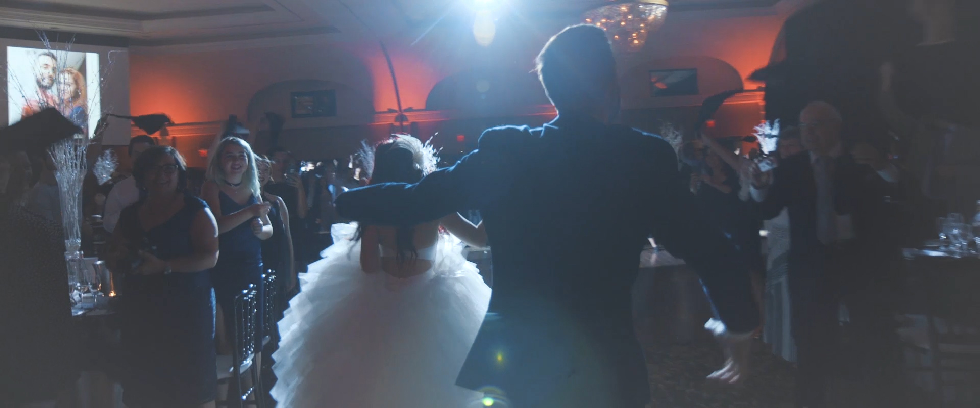 An image of a couple entering their hall on their wedding day; taken from a Toronto Wedding Video