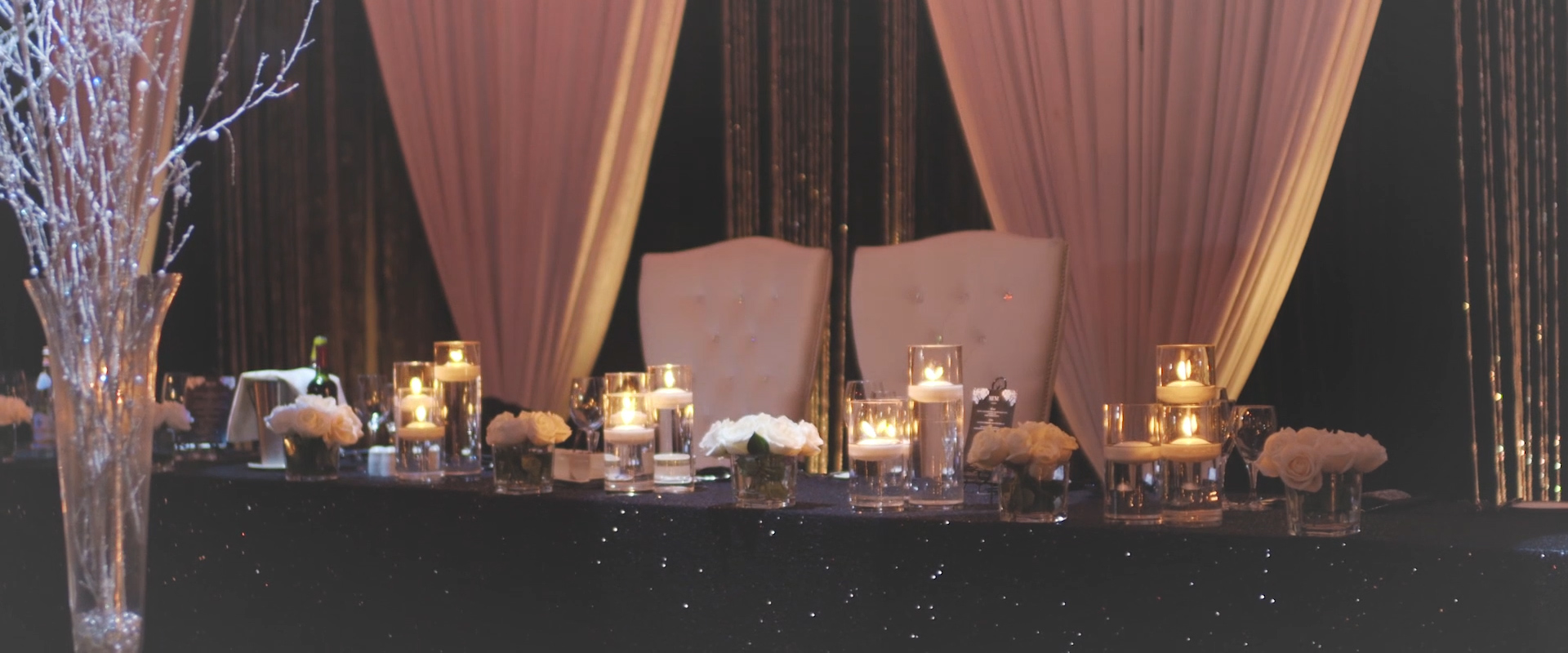 An image of table decor at a wedding reception hall; taken from a Toronto Wedding Video