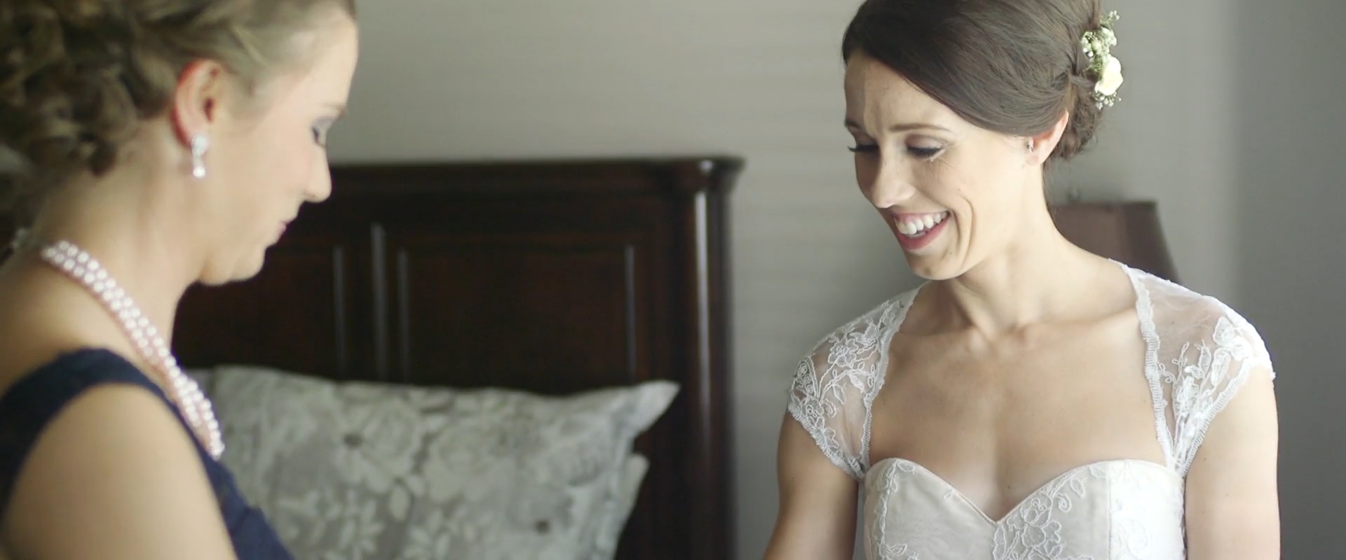An image of a bride getting ready; taken from one our Toronto Wedding Videography videos