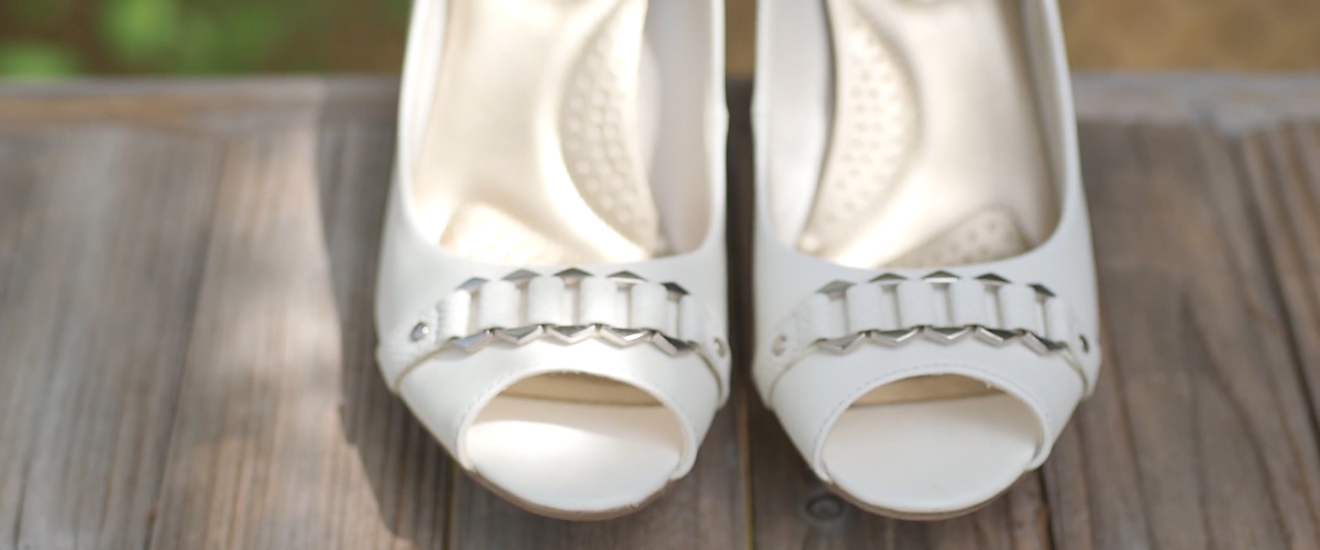 An image of a brides wedding shoes; taken from one of our Toronto Wedding Videography videos