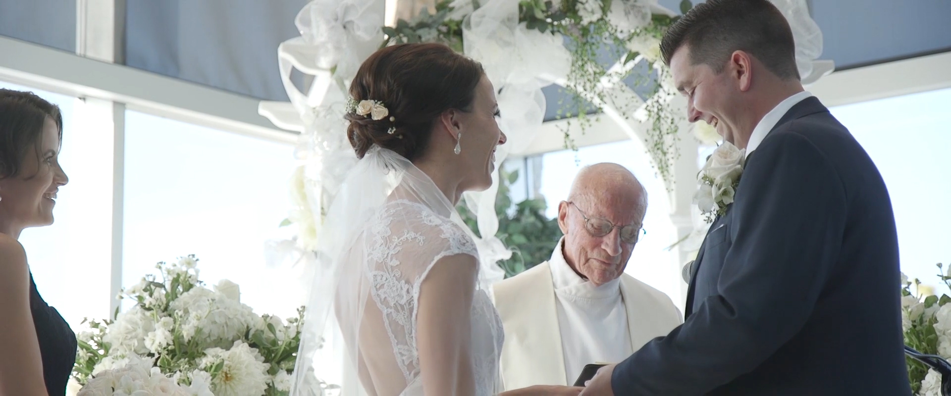 Image of a wedding couple reciting their vows at lionhead golf course; taken from one of our Toronto Wedding Videography videos