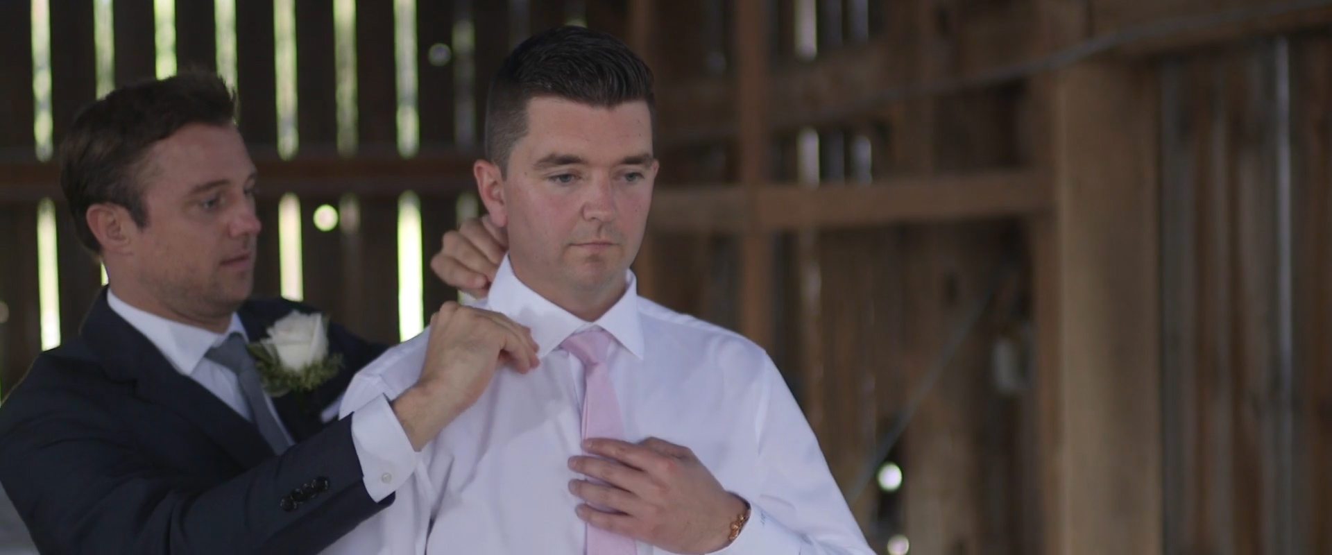 Image of a groom getting ready at lion head golf course, taken from one of our Toronto Wedding Videography videos