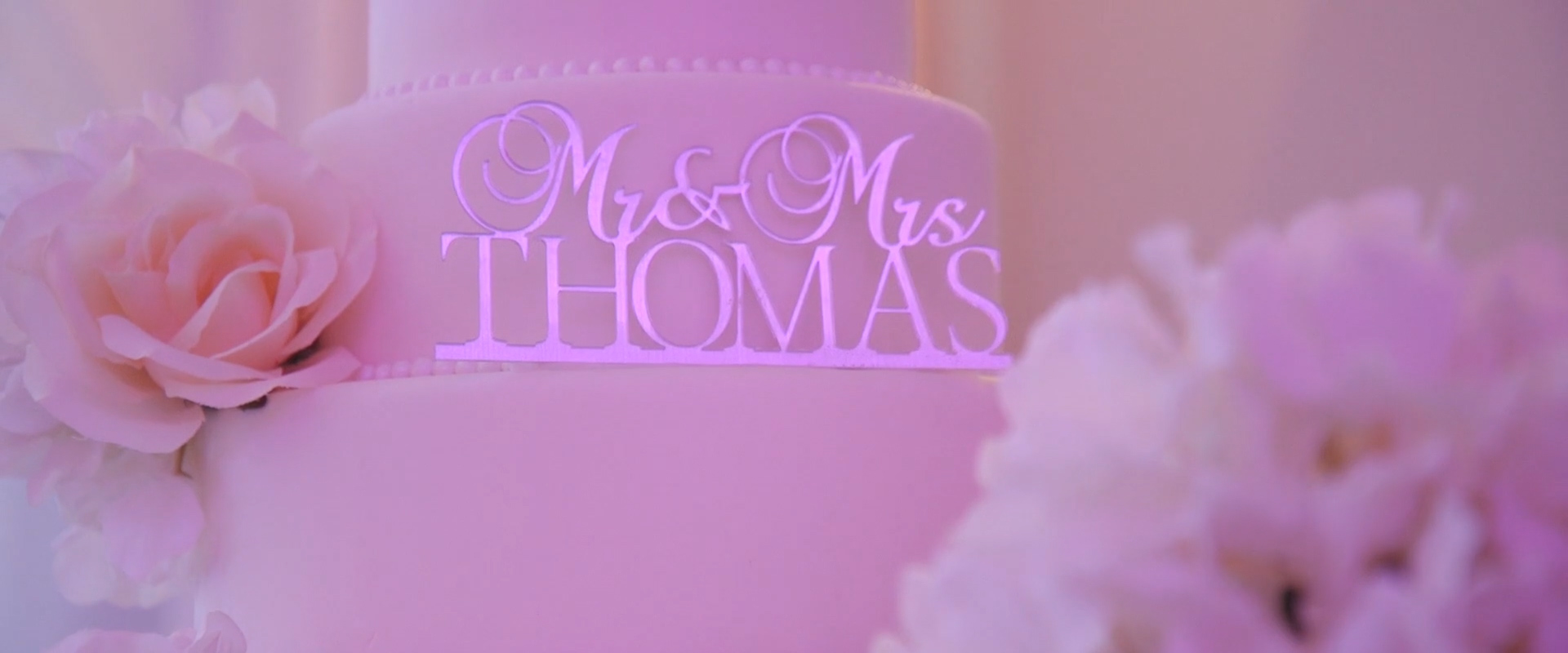Image of a cake topper taken from one of our Toronto Wedding Videography videos
