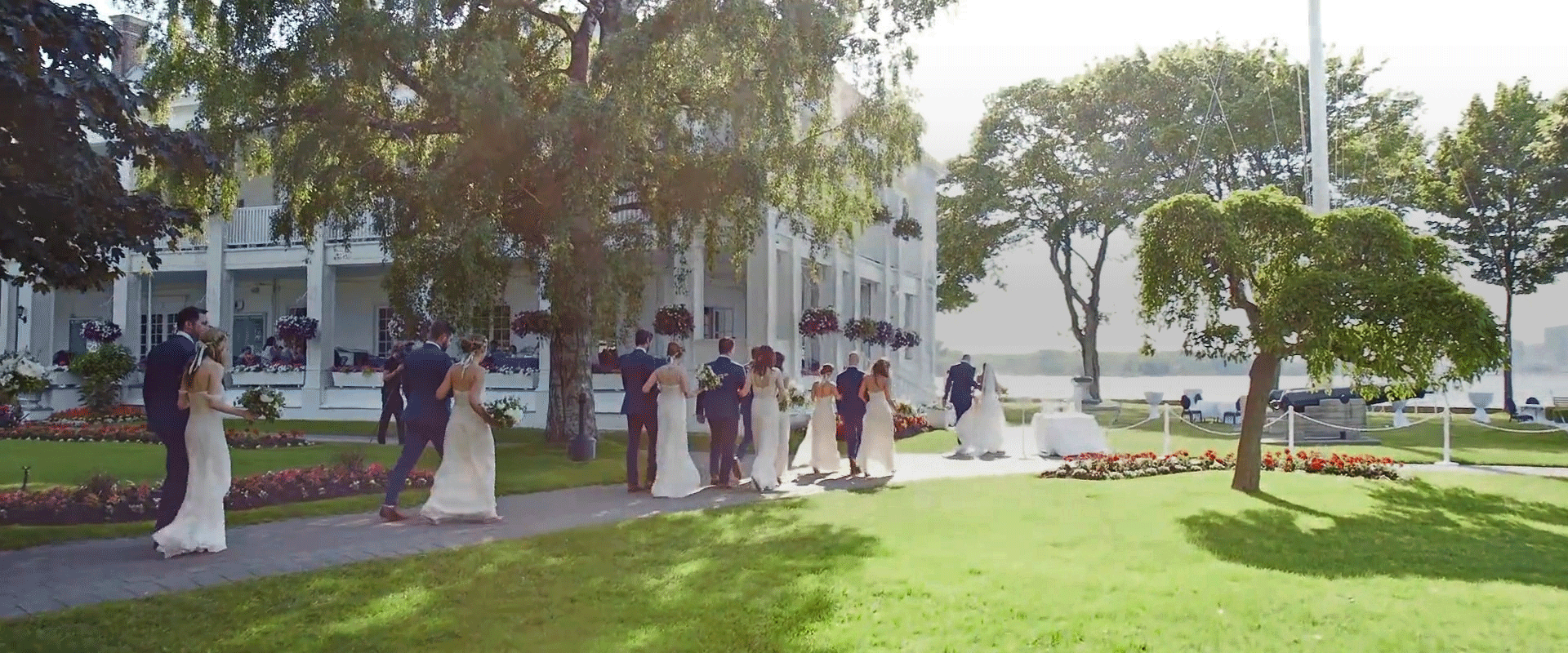 An image of the bridal party leaving the ceremony at the Royal Canadian Yacht Club; Taken from one of our Toronto Wedding Videography videos